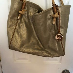 MK gold fabric purse.